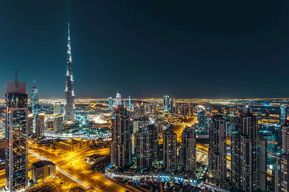 Aerial view of Dubai's business bay and Burj Khalifa at night, Dubai, UAE (United Arab Emirates)