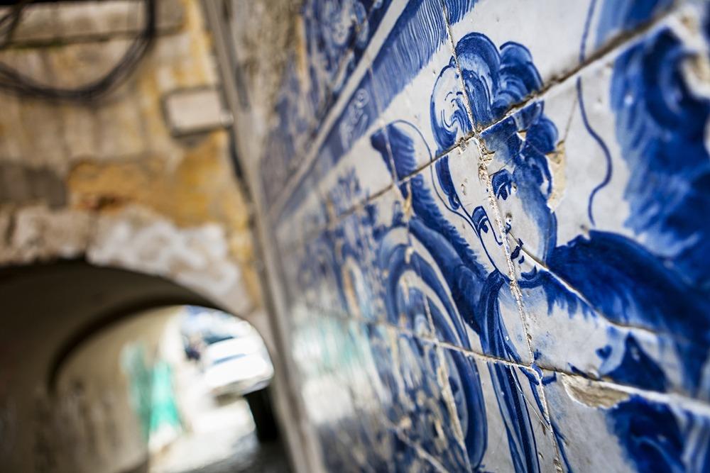 An angel figure in azulejo tiles in an alley in Lisbon, Portugal