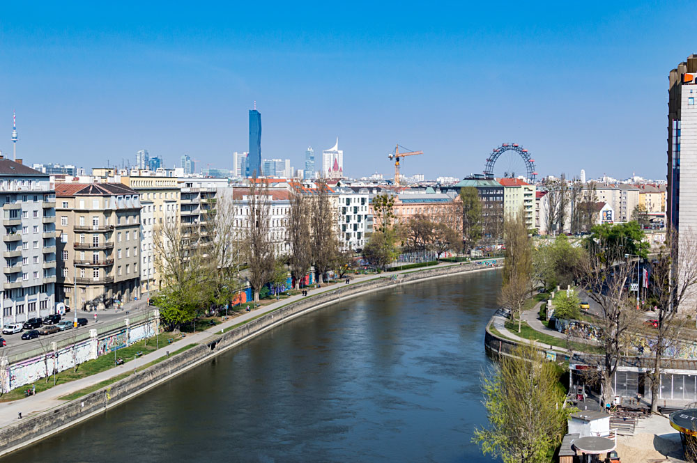 Cityscape around the Danube Canal looking toward Praterstern with the UNO city in the background, Vienna, Austria
