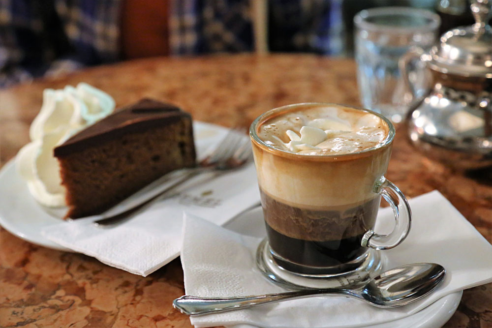 Coffee and cake (Sacherforte) at cafe in Vienna, Austria
