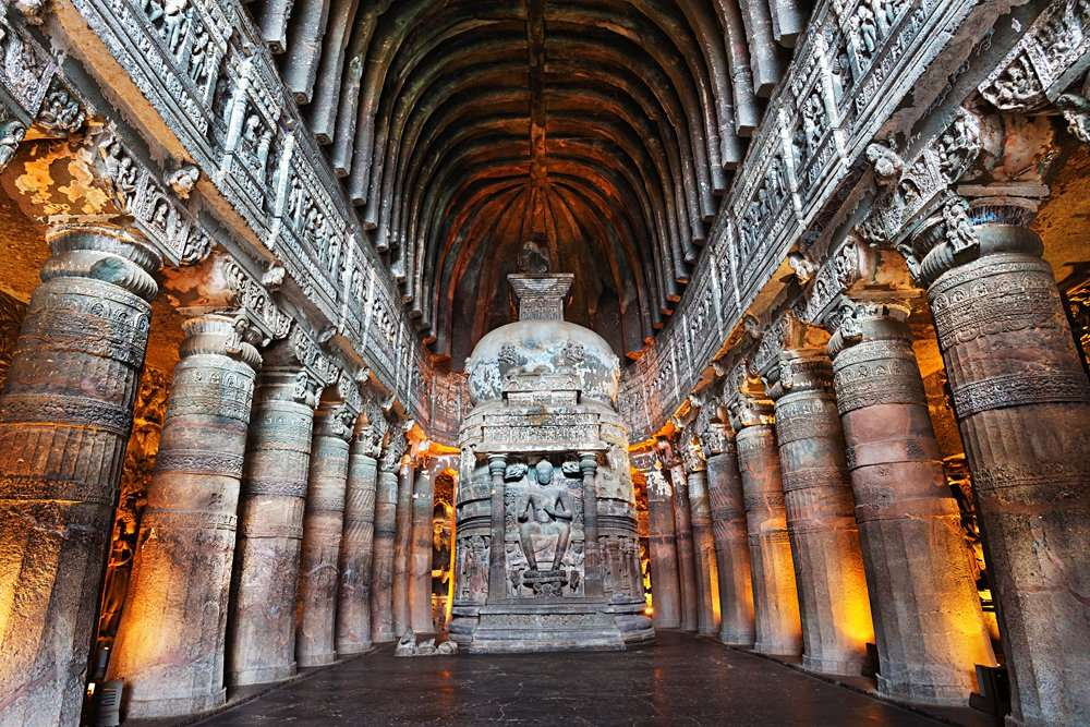 Interior of Ajanta Buddhist Cave with Buddha statue, Maharashtra, India