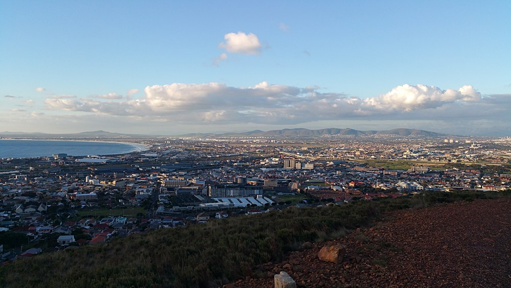 Sunset at Table Bay and northern districts of Cape Town including Woodstock, Western Cape, South Africa