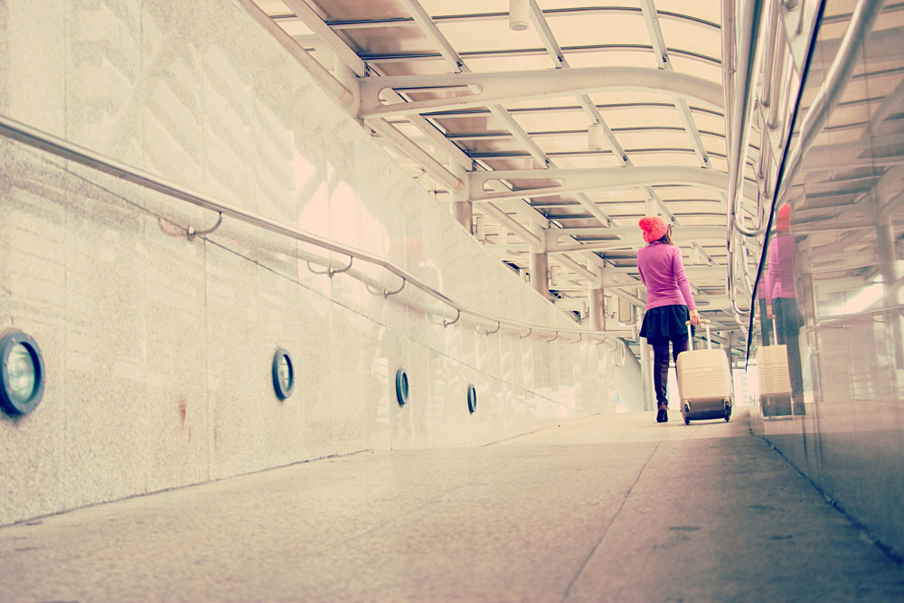 Woman is traveling alone arriving at station