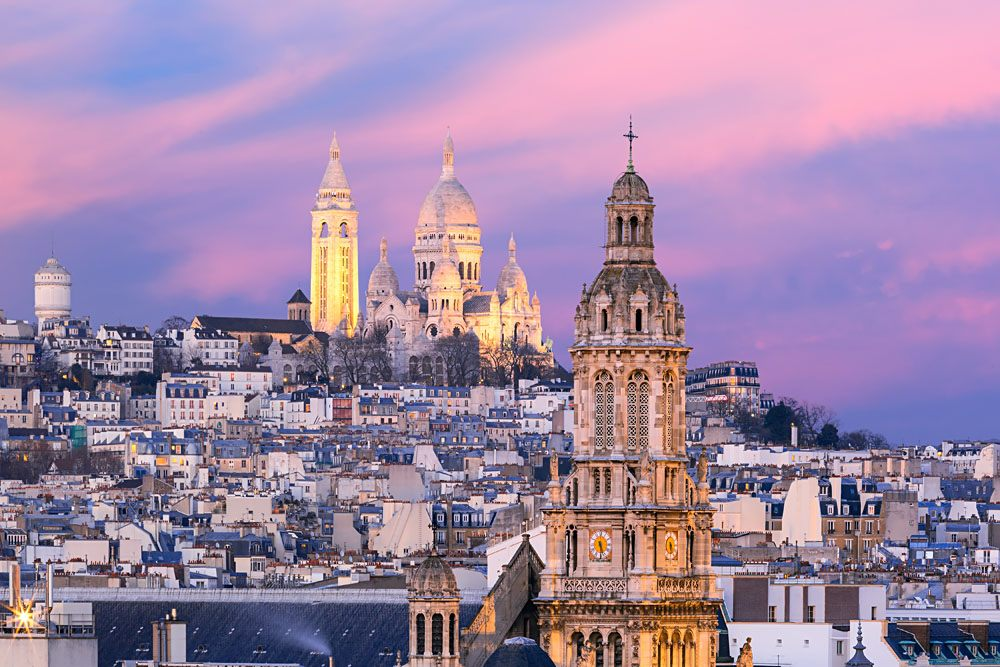 Aerial view of Sacre Coeur Basilica in Montmartre and Saint Trinity Church, Paris, France