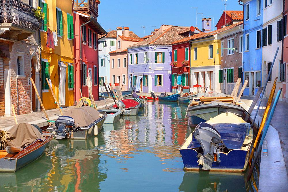 Colourful houses along a canal in the island of Burano in Venice, Italy