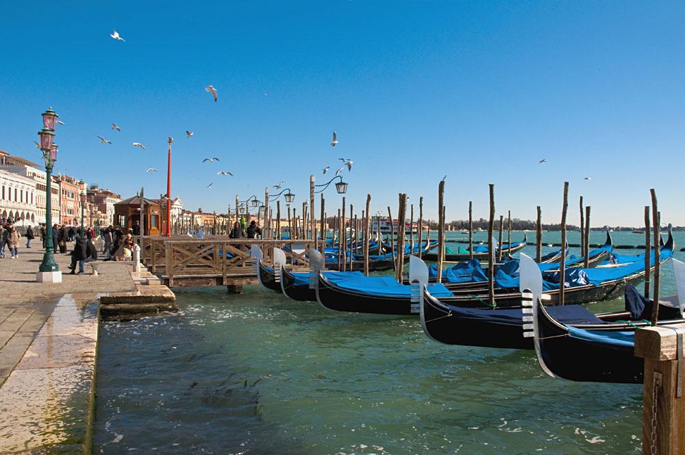 Gondolas at Riva degli Schiavoni at Venice, Italy