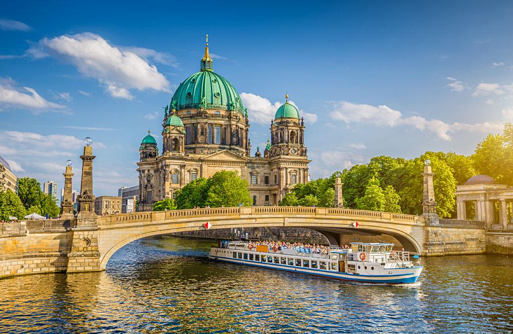 Historic Berlin Cathedral (Berliner Dom) at Museum Island with Friedrichsbrucke bridge on Spree River, Berlin, Germany