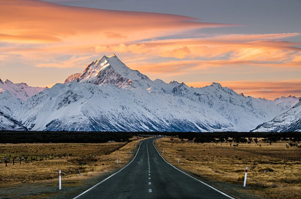 Majestic Aoraki or Mount Cook with road leading to Mount Cook Village in winter, New Zealand