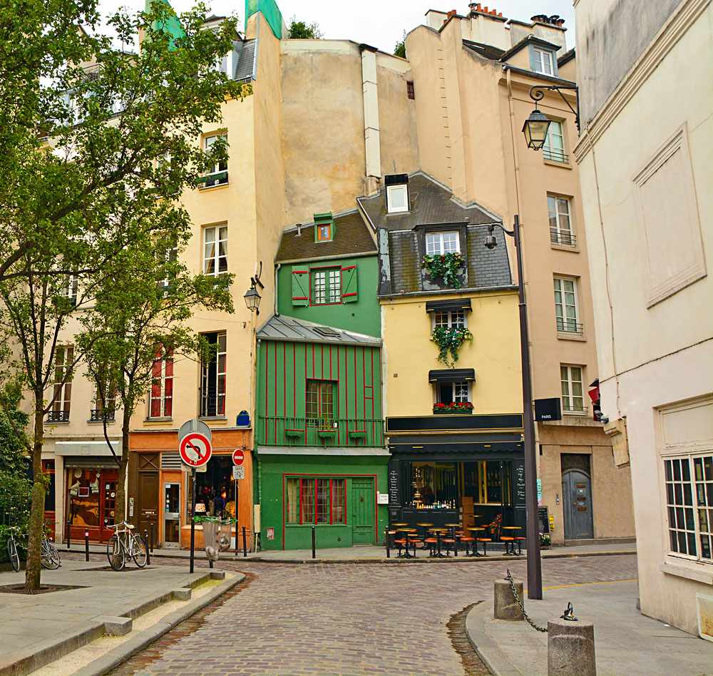 Narrow cobbled street among old traditional parisian houses in Latin Quarter of Paris, France