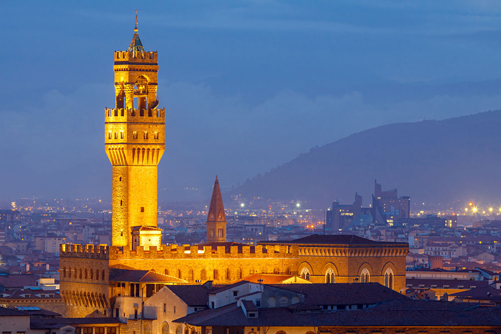 View of the Palazzo Vecchio illuminated at sunset, Florence, Italy
