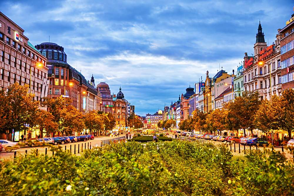 Buildings, people, and night life in Wenceslas Square, Prague, Czech Republic