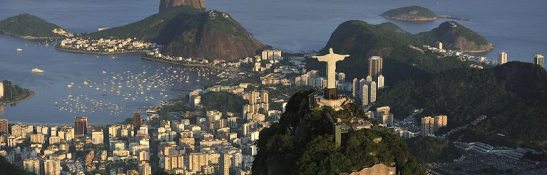 Christ the Redeemer statue on top of Corcovado Hill, overlooking Guanabara Bay and Sugarloaf, Rio de Janeiro, Brazil