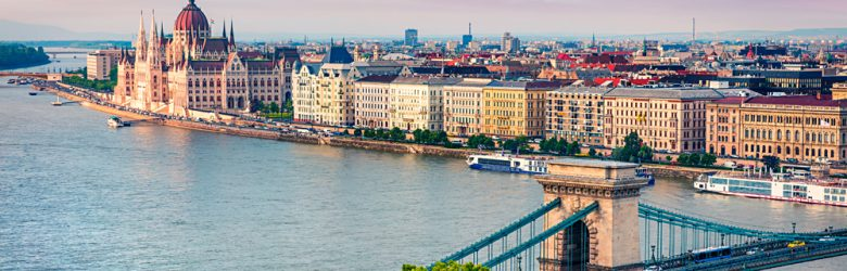 Colourful evening view of Parliament Building and Chain Bridge in Pest city, Budapest, Hungary