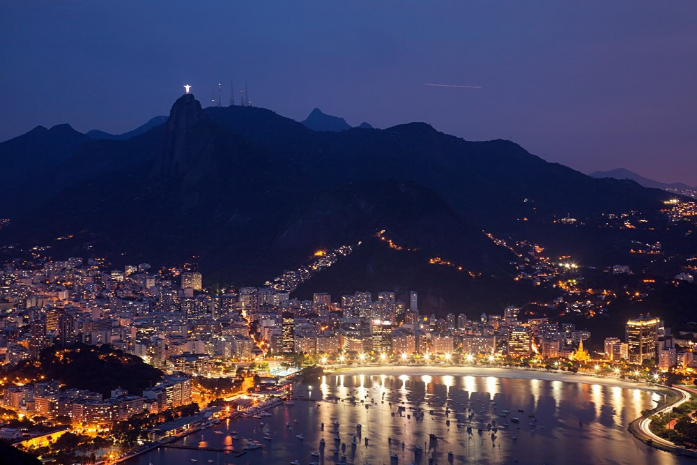Night view of Sugarloaf Mountain and Botafogo in Rio de Janeiro, Brazil