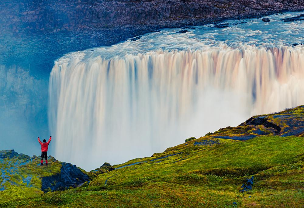 Standing in front of the powerful Dettifoss Falls, Jokulsargljufur National Park, Iceland