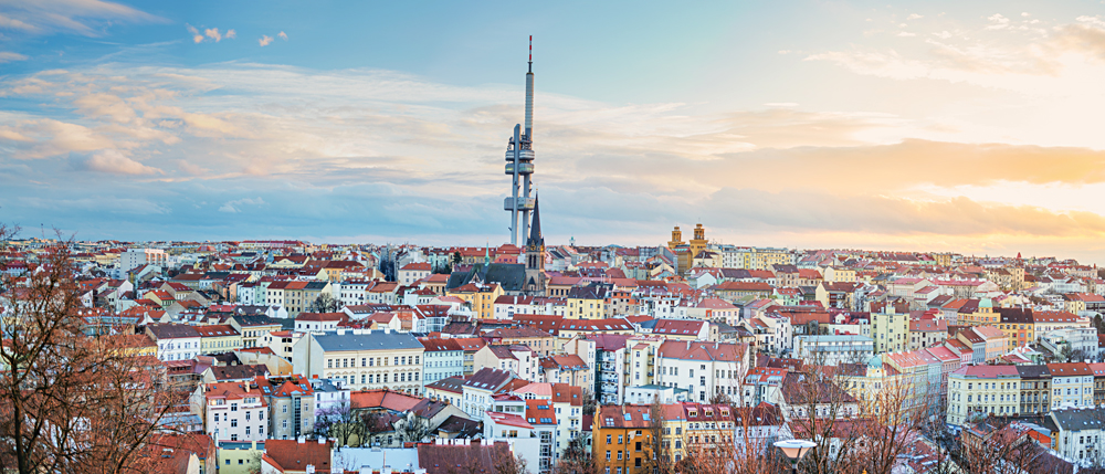 View of Prague and Zizkov Television Tower at sunset, Czech Republic