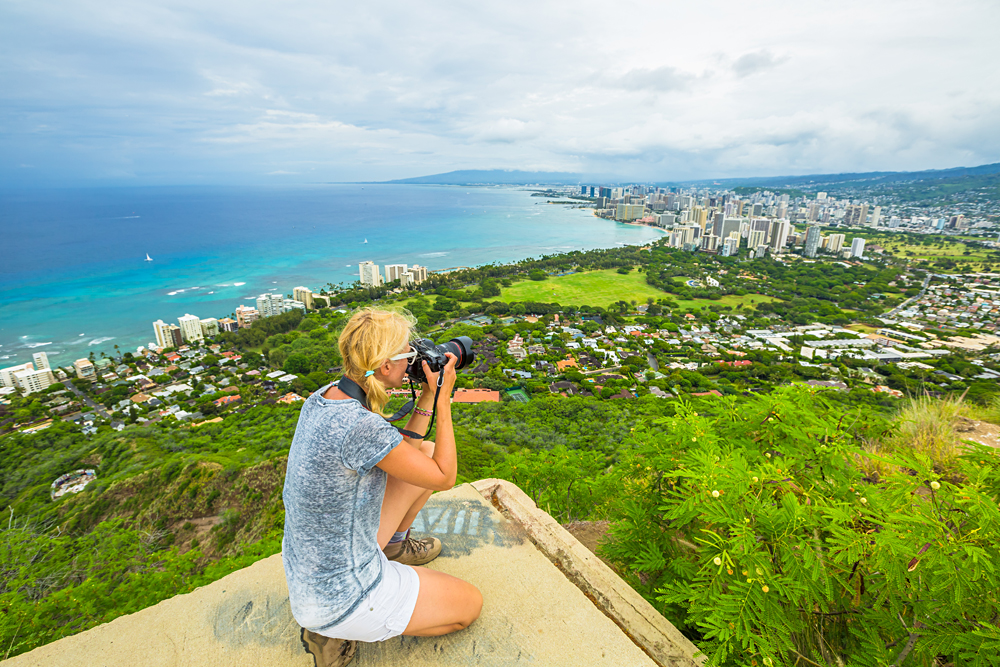 Woman Photographing Honolulu and Waikiki Beach from Diamond Head State Monument, Oahu, Hawaii, USA