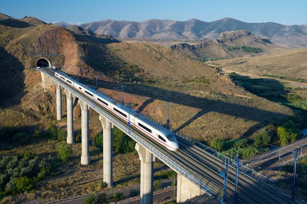Aerial view of AVE Madrid Barcelona high-speed train crossing a viaduct in Purroy, Zaragoza, Aragon, Spain