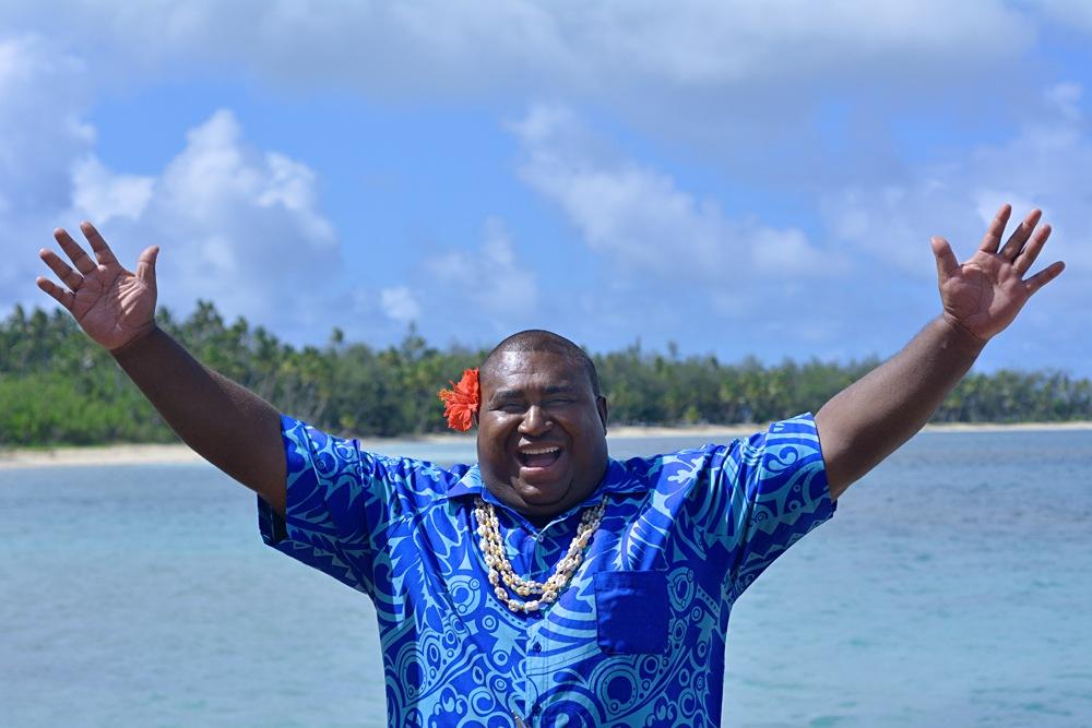 Bula greeting from Fijian man against the Blue Lagoon on Nanuya Lailai Island, Yasawa Islands, Fiji