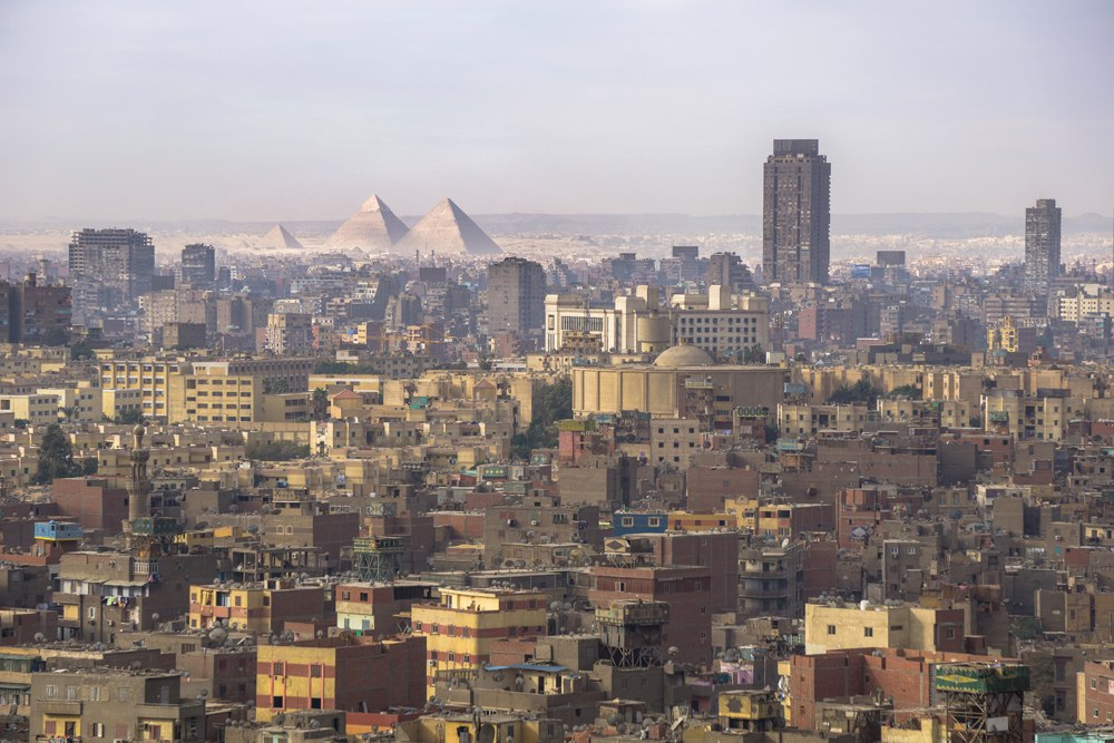 Cityscape view of Cairo, including Giza Pyramids, Egypt