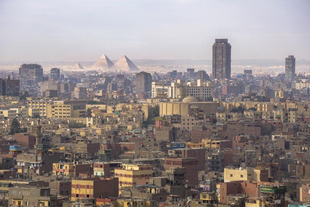 Cityscape view of Cairo, including Giza Pyramids, Egypt