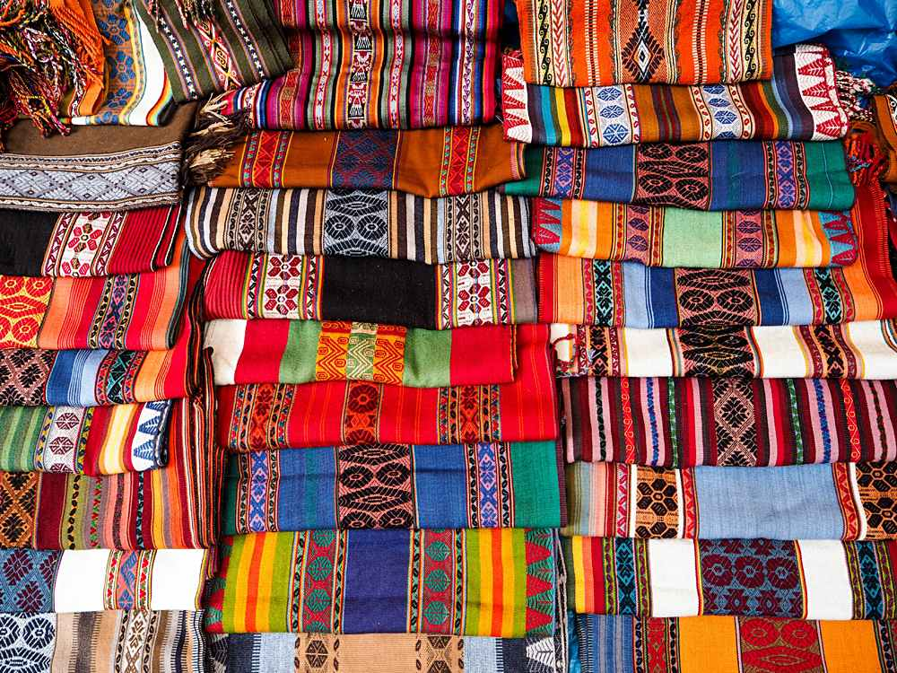 Colourful Textiles in Pisac Market near Cusco, Peru