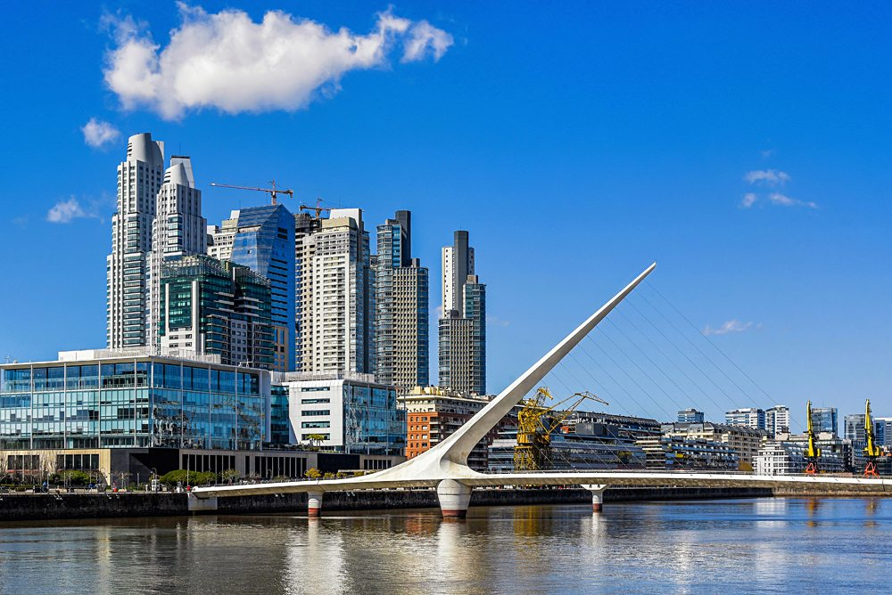 Daytime view at the waterfront in Puerto Madero with the Puente de la Mujer, Buenos Aires, Argentina