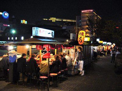Fukuoka's famous food stalls (yatai) located along the river on Nakasu Island, Kyushu, Japan