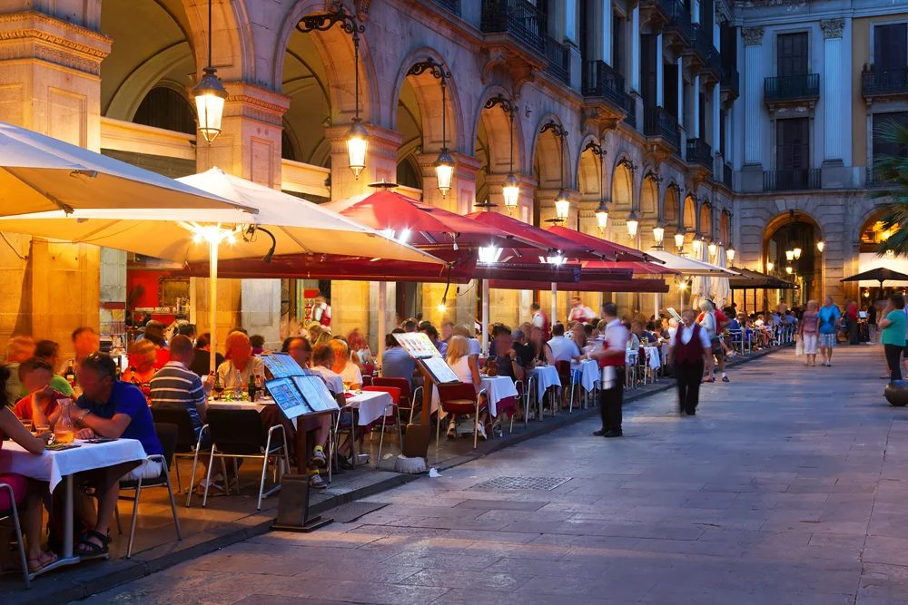 Street restaurants at Placa Reial in summer night, Barcelona, Spain