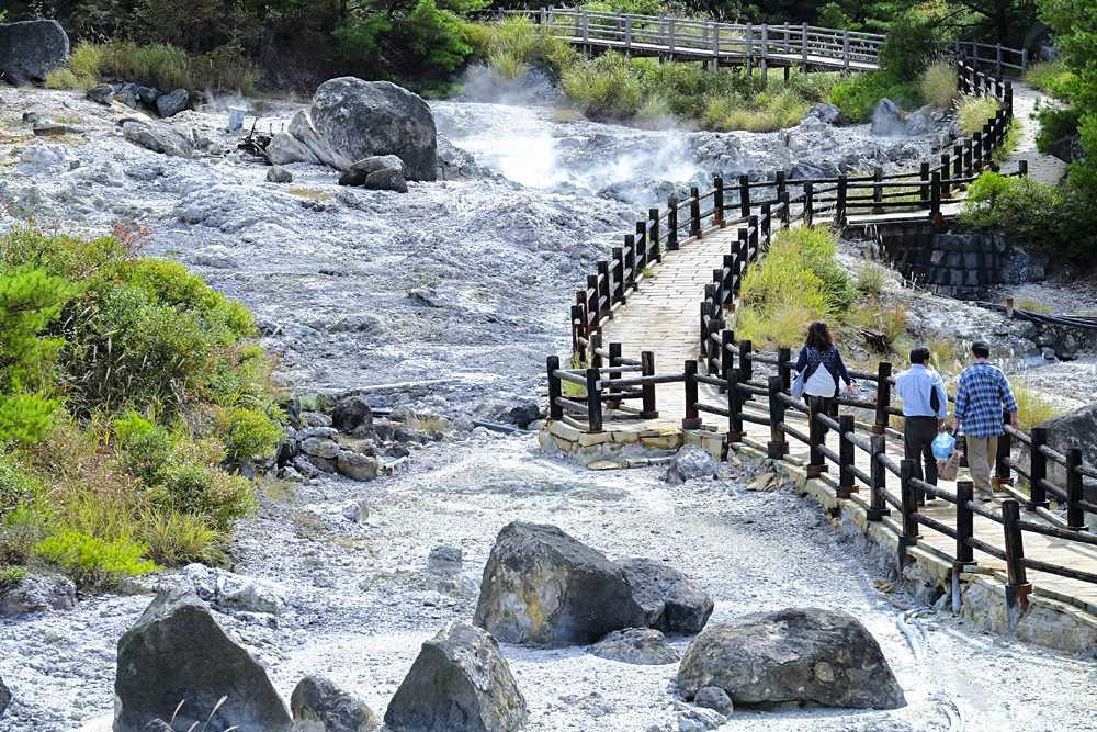 Tourists walking on trail at Unzen-Amakusa National Park in Nagasaki, Kyushu Island,Japan