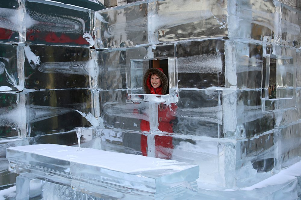 Woman at the bar of an ice hotel, Europe