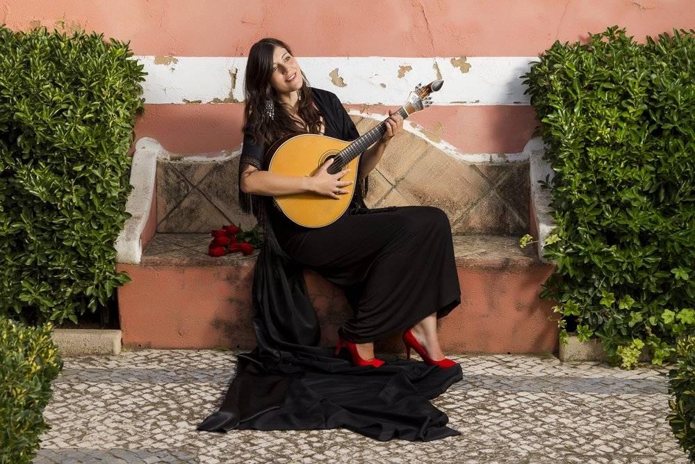 Woman performing traditional Portuguese Fado music, Portugal