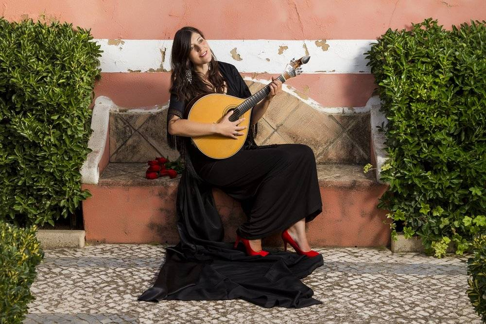 Woman performing traditional Portuguese Fado music, Portugal