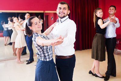 Young people dancing together at a Milonga, Argentina