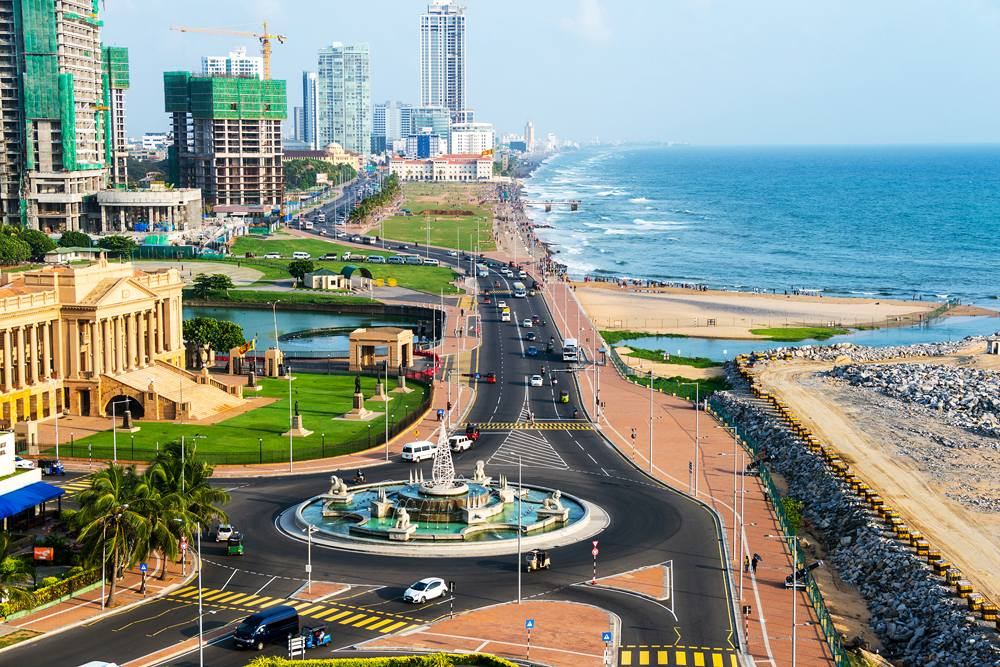 Aerial view of Colombo and coastal promenade, with construction of modern buildings, Sri Lanka