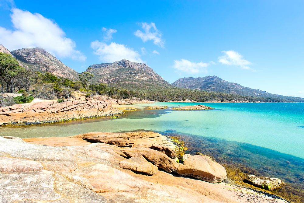 Honeymoon Bay on a clear day with blue water, Freycinet National Park, Tasmania, Australia
