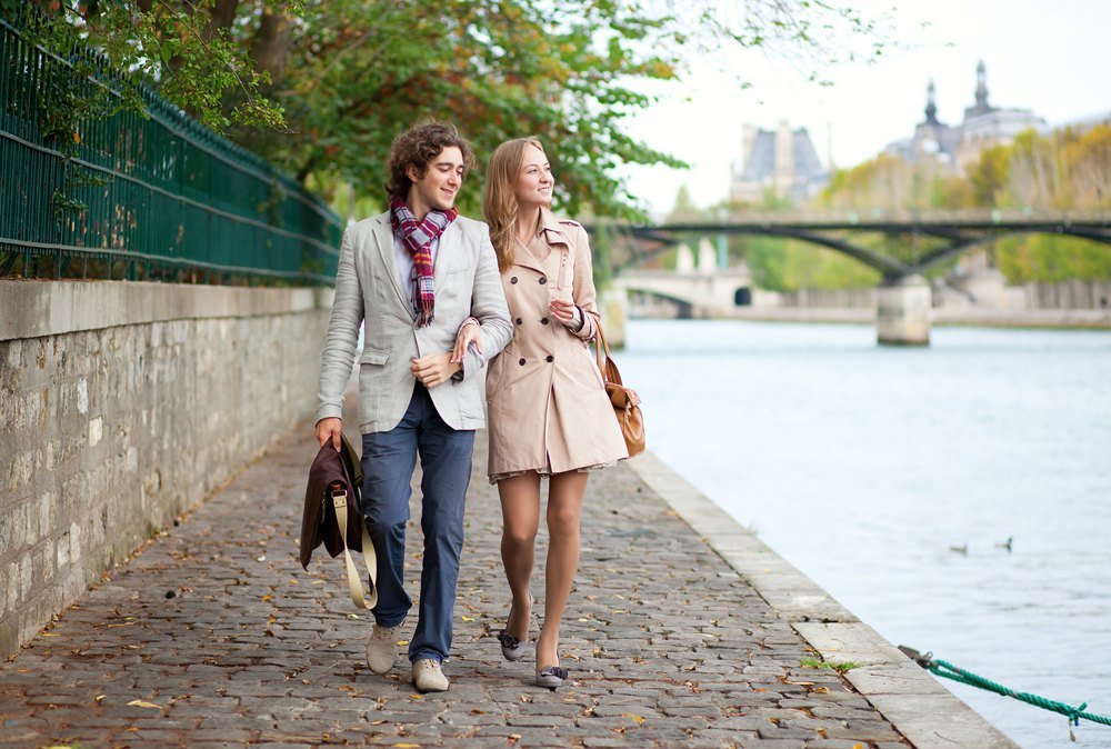 Romantic couple at the embankment of River Seine in Paris, France