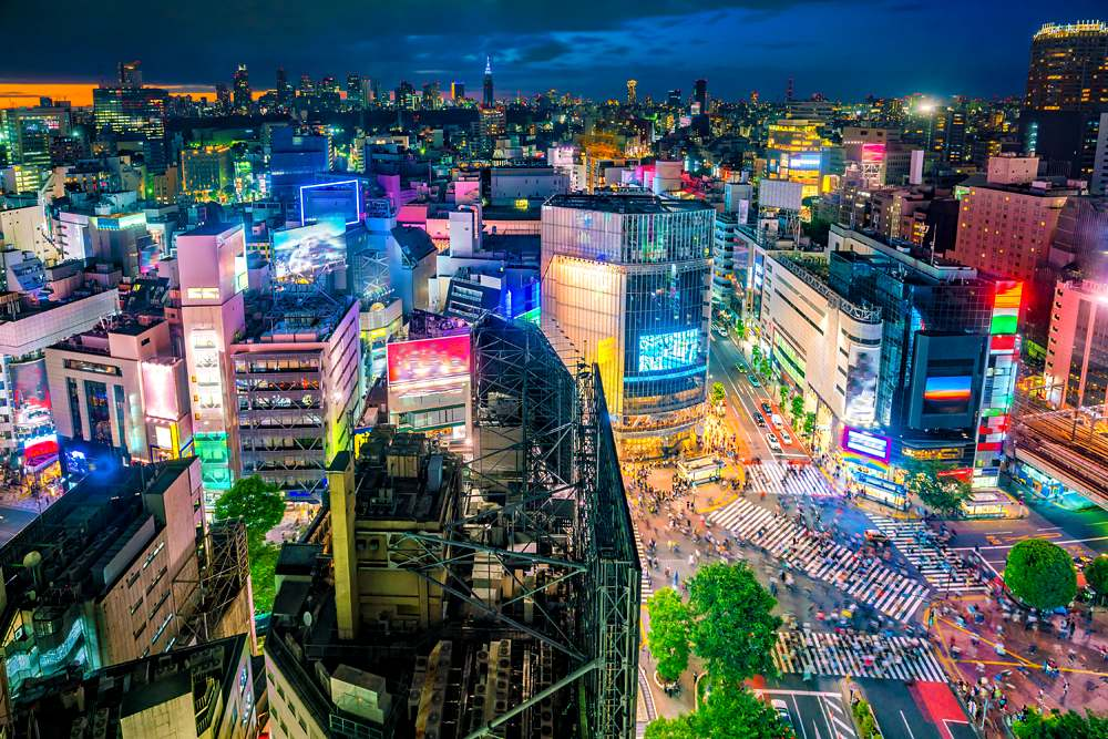 View of Shibuya Crossing and surrounding neon lights at twilight, Shibuya, Tokyo, Japan