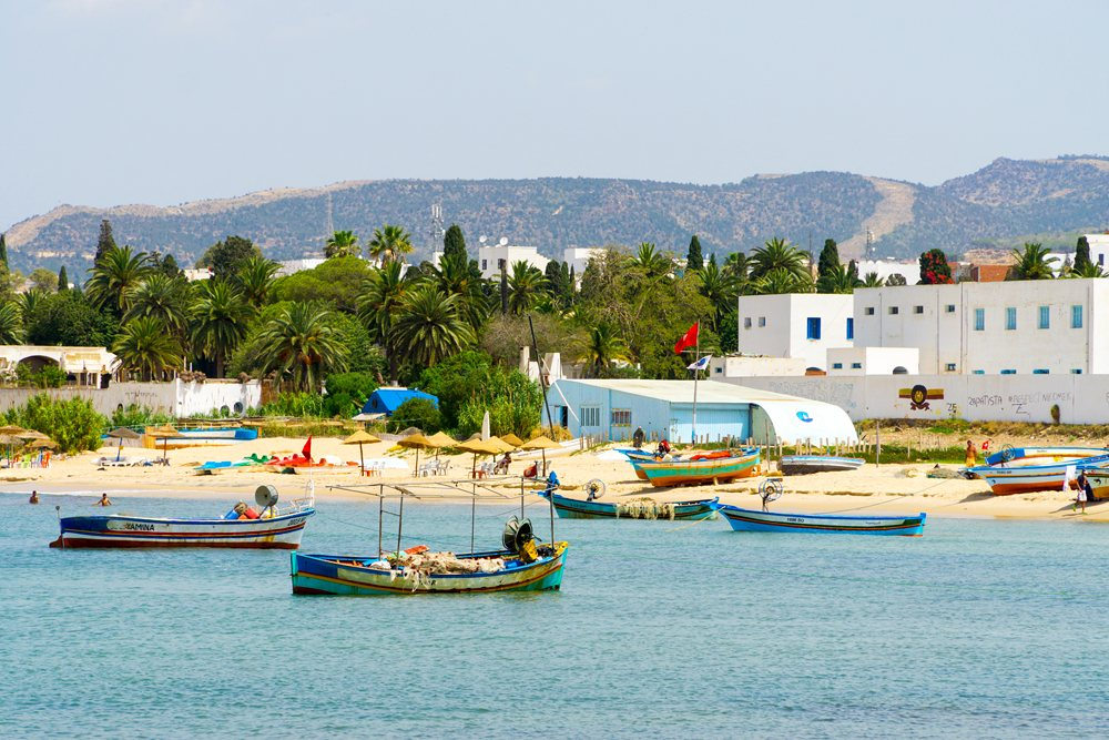 View of the beach, fishing boats, and sea in Hammamet, Tunisia