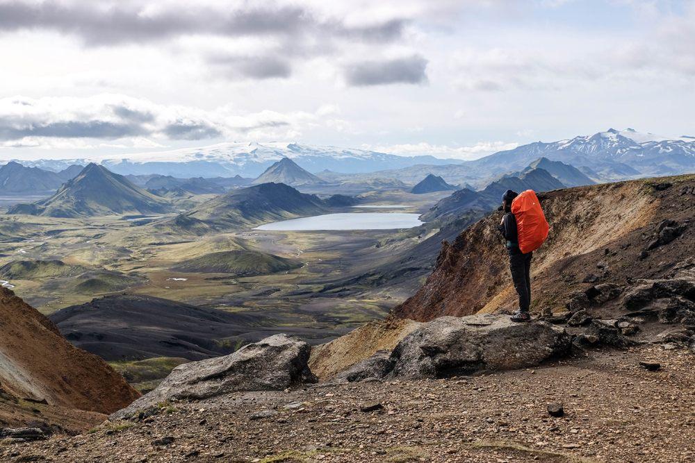 Woman hiker enjoying the view on lake Alftavatn in Iceland on Laugavegur trail, Iceland