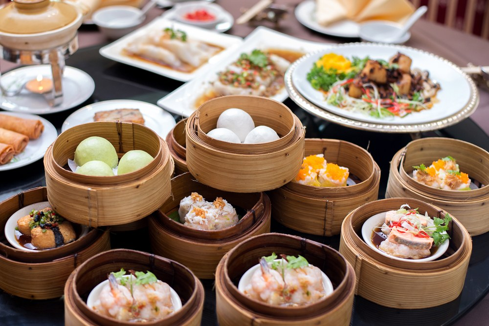 Arrangment of various dim sum in bamboo steamers, Asia
