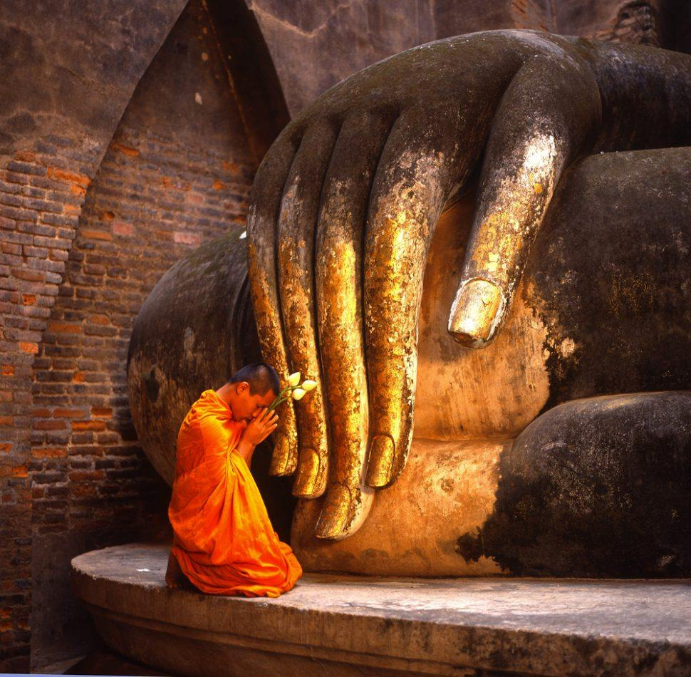 Thailand Tourism - Young Monk Praying in Si Chum Temple, Sukhothai Historical Park, Sukhothai, Thailand-00006805