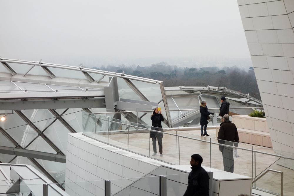 Tourists visiting the Fondation Louis Vuitton arts centre, Paris, France