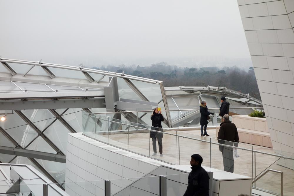 Tourists visiting the Fondation Louis Vuitton arts centre, Paris, France