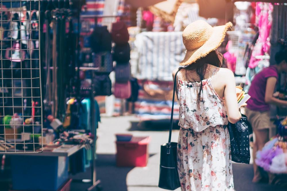 Young woman visiting at Mongkok Ladies Market in Hong Kong, China