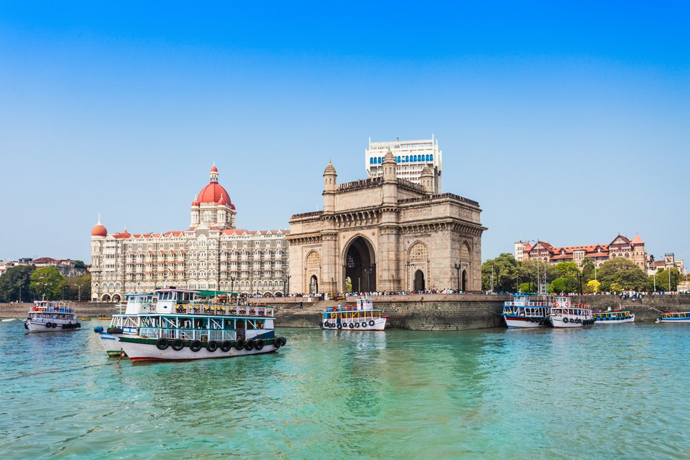 Gateway of India and boats, plus the famous Taj Hotel, Mumbai, India