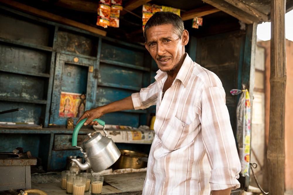 Indian man preparing Masala Tea, India