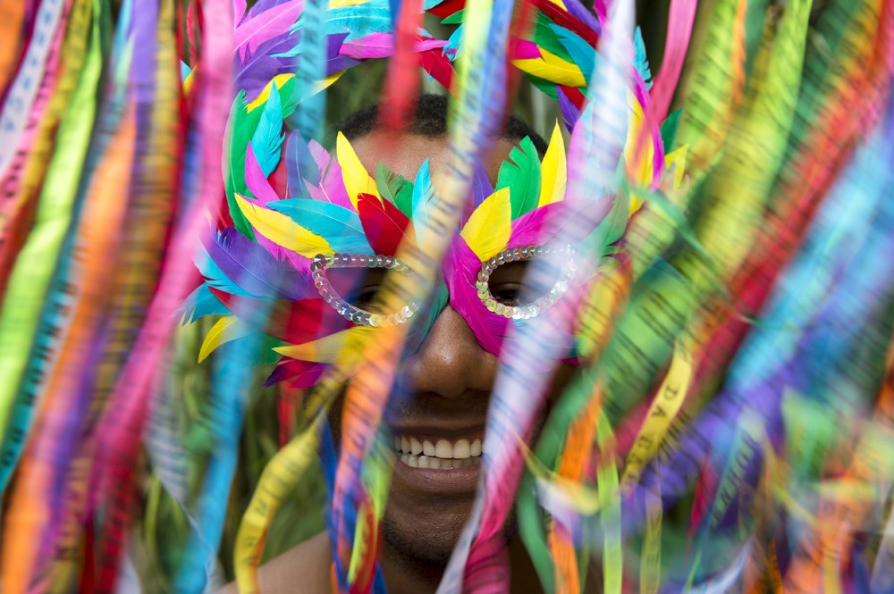 Smiling Brazilian man in colourful mask at Carnival in Rio, Brazil