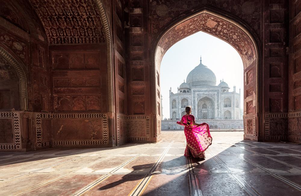 Woman in red sari in the Taj Mahal, Agra, Uttar Pradesh, India