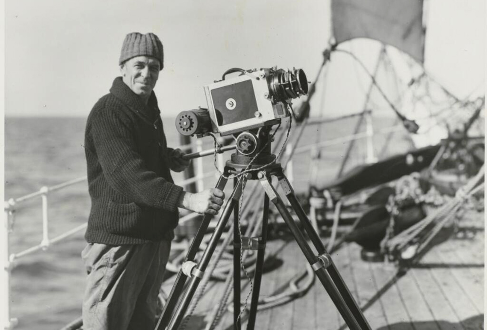 Captain Frank Hurley with a camera on board the Discovery, circa 1931